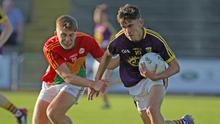 Wexford wing-forward Niall Connolly taking on David Dunphy of Carlow
