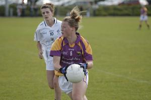 Caoimhe Denton holds possession is first half