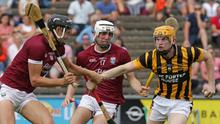 Simon Donohoe of Shelmaliers under pressure from his county colleague Jack O'Connor, and St. Martin's Senior debutant Conor Coleman