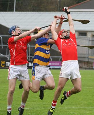 Outstanding midfielder Garrett Foley catches with Daire Barden offering support