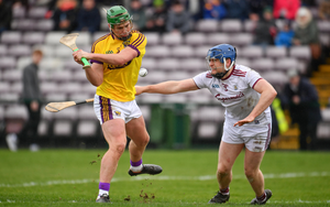 Conor McDonald scoring his second goal despite the best efforts of Galway's Paul Killeen