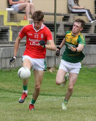 Mark Byrne racing away from HWH-Bunclody defender Billy Kelly