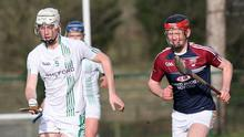 Wing-back Billy Dunne racing away from Jack Ryan of Borris