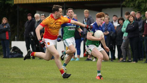 James Stafford of Glynn-Barntown tries to avoid the clutches of Conor Halligan (Sarsfields)