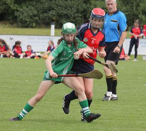 Lisa Murphy (Cloughbawn) holds on to possession despite the close attention of Aoibhe McSweeney (Kilrush)
