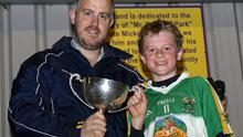 Johnny Murphy presents the cup to James Lawless