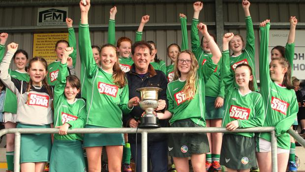 The Clonroche girls celebrate after receiving the trophy from Jim Dempsey of the Rackard League