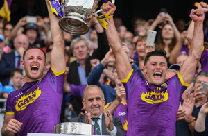 A fantastic moment 15 years in the making as joint captains Matthew O'Hanlon and Lee Chin lift the Bob O'Keeffe Cup