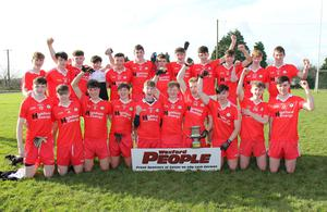 Ballinastragh Gaels celebrate after capturing the Wexford People Minor football Roinn 1 championship title on Saturday