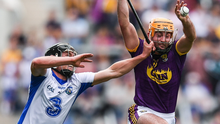 Eoin Moore puts his best foot forward to win possession ahead of Waterford's Páuric Mahony