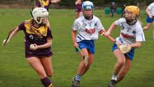 Katie Bates of Wexford under pressure from Waterford pair Rachel Jones and  Helen Connolly