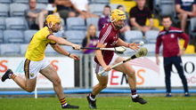 Wexford full-back Darren Byrne trying to keep tabs on Galway's Seán Bleahene