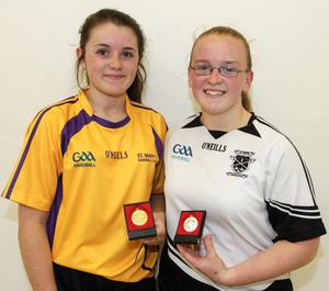 Holly Hynes (left) beat Roisin Walsh in the ladies' junior singles final
