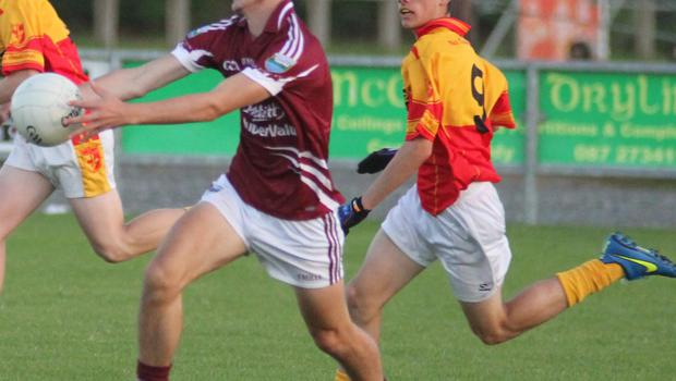 St Martin's Adam Cantwell and Sarsfield's Ben Butler