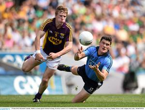Michael Furlong, seen here in action last year against Dublin's Diarmuid Connolly, will miss Saturday's qualifier at home to Down owing to injury