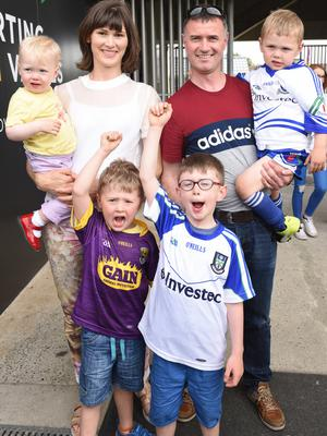 Micheál McGuinness from Monaghan and his wife Aine  (nee Codd of St. Martin's, an All-Ireland camogie winner with Wexford) at the game with their children: Niamh, Tadhg, Eoghan and Maidhc