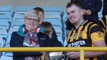 Eoin Doyle receiving the cup from Margaret Doyle (Co. Secretary).