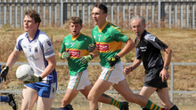Páraic Redmond of Craanford coming out of defence as Clongeen duo Richard Rochford and Shane Cahill give chase