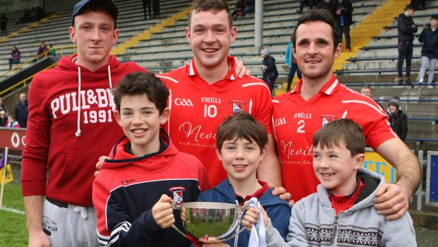 Bryan, Eddie and Martin Power, grandsons of James Gleeson, after the Leinster final win with Pádraic, Oisín and Odhrán Gleeson, great-grandsons of James Gleeson, who played with St. Mogue's in their first-ever county title win in 1917