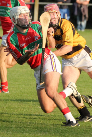 Ricky Fox (Rapparees) is challenged by Brendan O'Leary (Rathnure)