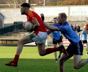 Richie Farrell leaps through the air after beating Simonstown's Brian Conlon to the ball