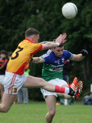 Fran Cleary (Sarsfields) is a fraction too late in his bid to block the kick of Rioghan Crosbie (Glynn-Barntown)