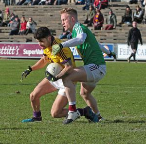 Paul Curtis, who finished the game with a three-point haul, taking on Westmeath defender Killian Daly