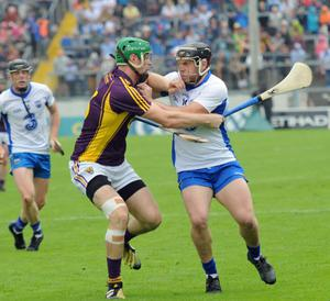 The captains collide as Matthew O'Hanlon tackles Kevin Moran. Photograph: George Hatchell