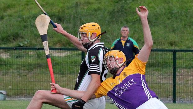 Colm Bennett (Marshalstown-Castledockrell) in a tussle with Eamonn Doyle (Duffry Rovers)