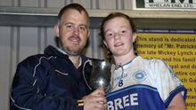 Bree captain Amy Doyle receives the silverware from Johnny Murphy
