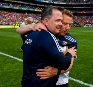 Selector J.J. Doyle congratulating manager Davy Fitzgerald after the Leinster final victory