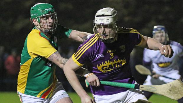 Full-back Liam Ryan is close to his own endline as Carlow's Craig Wall applies pressure