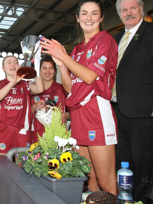 Katie O'Connor, the St. Martin's captain, after receiving the cup