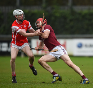 Daithí Waters of St. Martin's is challenged by Cuala attacker Colm Cronin