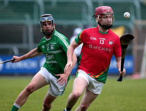 Darragh Pepper (Rapparees) evades Peter Travers (Naomh Eanna) in Friday's Pettitt's Senior hurling championship clash in Chadwicks Wexford Park. The Rapps were the first big-name casualties when they were knocked out following a last-gasp penalty goal