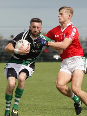 Daithí Moore of Kilmore is challenged by Ronan Devereux