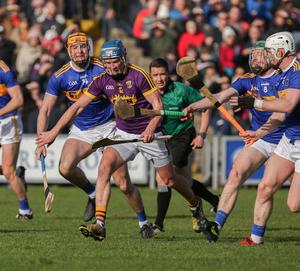 Wexford attacker Ian Byrne under pressure from Tipperary trio Seamus Callanan, Robert Byrne and Michael Breen
