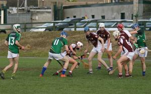 Seán Bookey of F.C.J. takes possession under pressure from Niall Parker of Enniscorthy C.B.S., while his team-mates Seamus Doyle (3), Garrett O'Connor(4) and Paddy O'Hagan (6) await the outcome