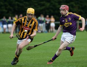 Wexford's Micheál O'Connor pursues Kilkenny midfielder Aaron Brennan