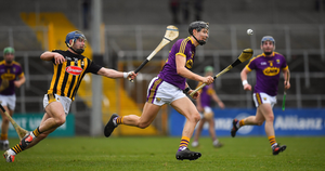 Wexford wing-forward Jack O'Connor on the move away from Kilkenny's Ger Aylward during Sunday's clash in Nowlan Park