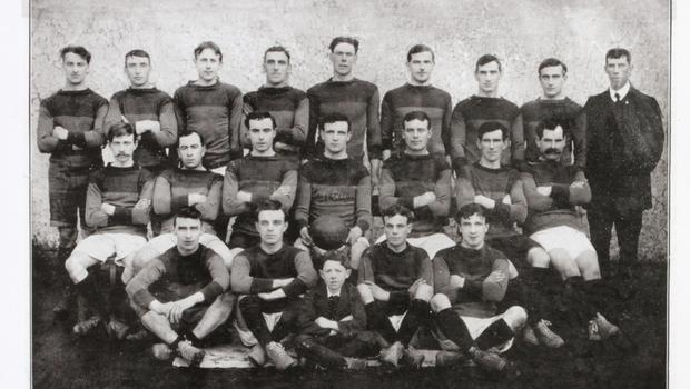 A Wexford Senior football squad from the county's golden era which culminated in four All-Ireland successes on the trot from 1915 to 1918. Eleven of the 15 players who started the 1915 final are featured here as follows - Paddy Mackey (extreme left, back row), Aidan Doyle (second left, back row), Fr. Edmund Wheeler (sixth, back row), TomMcGrath (seventh, back row), Jim Byrne (eighth, back row), TomMernagh (second, middle row), Tom Murphy (third, middle row), Seán O'Kennedy (fourth, middle row), Tom Doyle (fifth, middle row), Rich Reynolds (second, front row), Gus O'Kennedy (extreme eight, front row). Second from right in the front row is Jimmy Rossiter who was killed in action during World War One, just a few weeks before the All-Ireland victory of 1915
