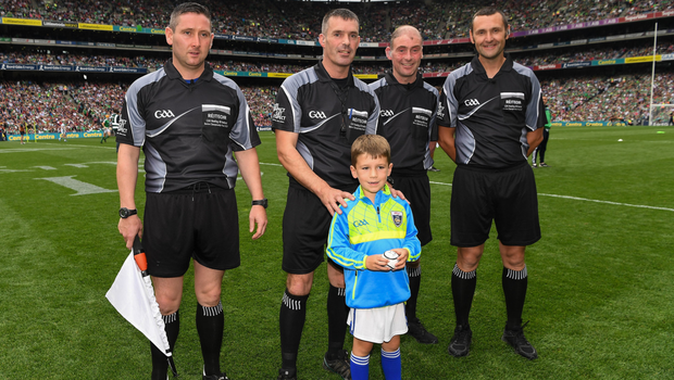 James Owens before the 2018 All-Ireland final with six-year-old Rian O'Connor, who presented him with the match ball, and his fellow officials Fergal Horgan (Tipperary), Seán Cleere (Kilkenny) and Patrick Murphy (Carlow) - referee for the Minor final between Galway and Kilkenny next Sunday. Photo by Ray McManus/Sportsfile