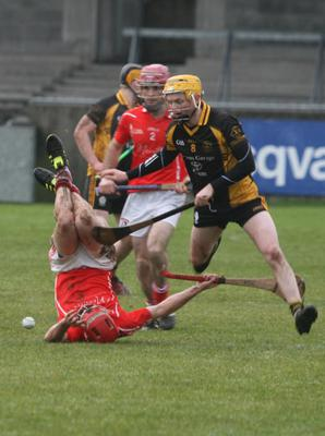 Fethard's Garrett Foley takes a tumble in the poor conditions in Donnycarney on Saturday
