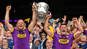 Wexford joint captains Matthew O'Hanlon and Lee Chin lifting the Bob O'Keeffe Cup in 2019. Photo by Ramsey Cardy / Sportsfile