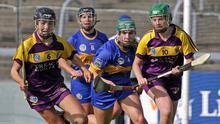 Wexford's Ciara O'Connor and Kate Kirwan get to the ball ahead of Mary Ryan and Clodagh Quirke