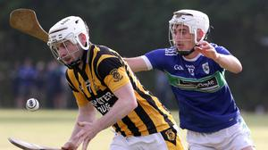 Jody Donohoe (Shelmaliers) trying to escape the attention of Glynn-Barntown's Cormac Cooney