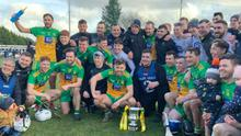 Luke White (middle row, third left) and his Donegal team-mates celebrate after their 1-18 to 0-19 win over Armagh in the National League Division 3A final in Carrickmore on March 8