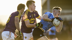 Jim Rossiter tackling Paddy Small when Wexford met Dublin in the O'Byrne Cup in St. Patrick's Park three years ago. Photo: Sportsfile