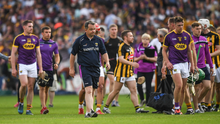 A dejected Davy Fitzgerald leaving the field along with Aidan Nolan after Saturday's one-point defeat. Photo by Ray McManus/Sportsfile