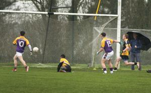 Ashley Tully (15) scoring one of his two goals for St. Patrick's in Saturday's final in Craanford